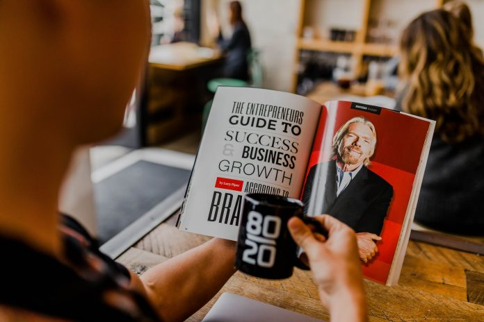 A person reading an inspirational book featuring Richard Branson