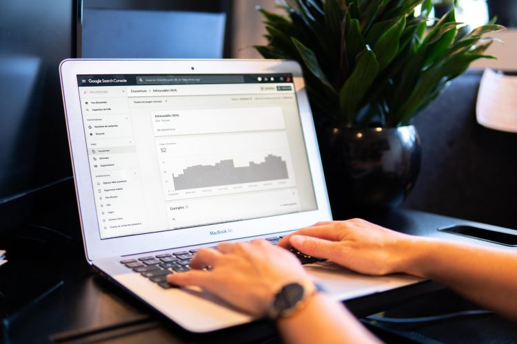 A person using Google Search Console on his laptop for better SEO of the website