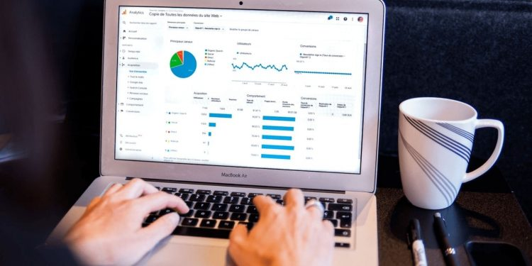 A person using best ecommerce tools google analytics on laptop